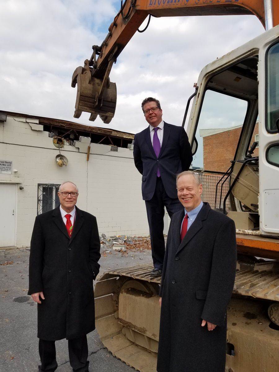 Pictured (left to right): Franklin County Commissioner Bob Thomas, Commissioner Chairman Dave Keller (top) and Commissioner Bob Ziobrowski stand with an excavator as demolition begins on the North Main Street site of the Court Facility Improvement Project.