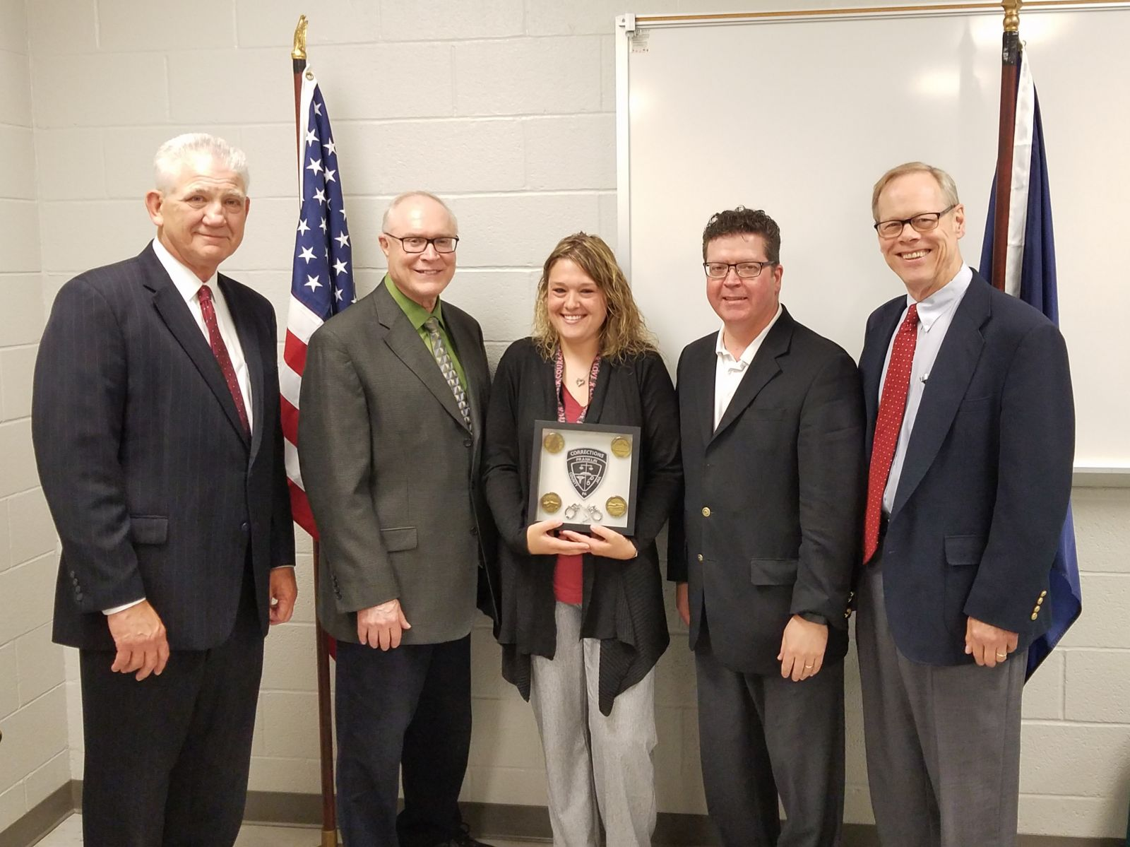 Pictured above, left to right: Former County Administrator John Hart, Commissioner Bob Thomas, Correctional Treatment Specialist and Correctional Worker of the Year Heather Franzoni, Commissioner Chairman Dave Keller, Commissioner Bob Ziobrowski