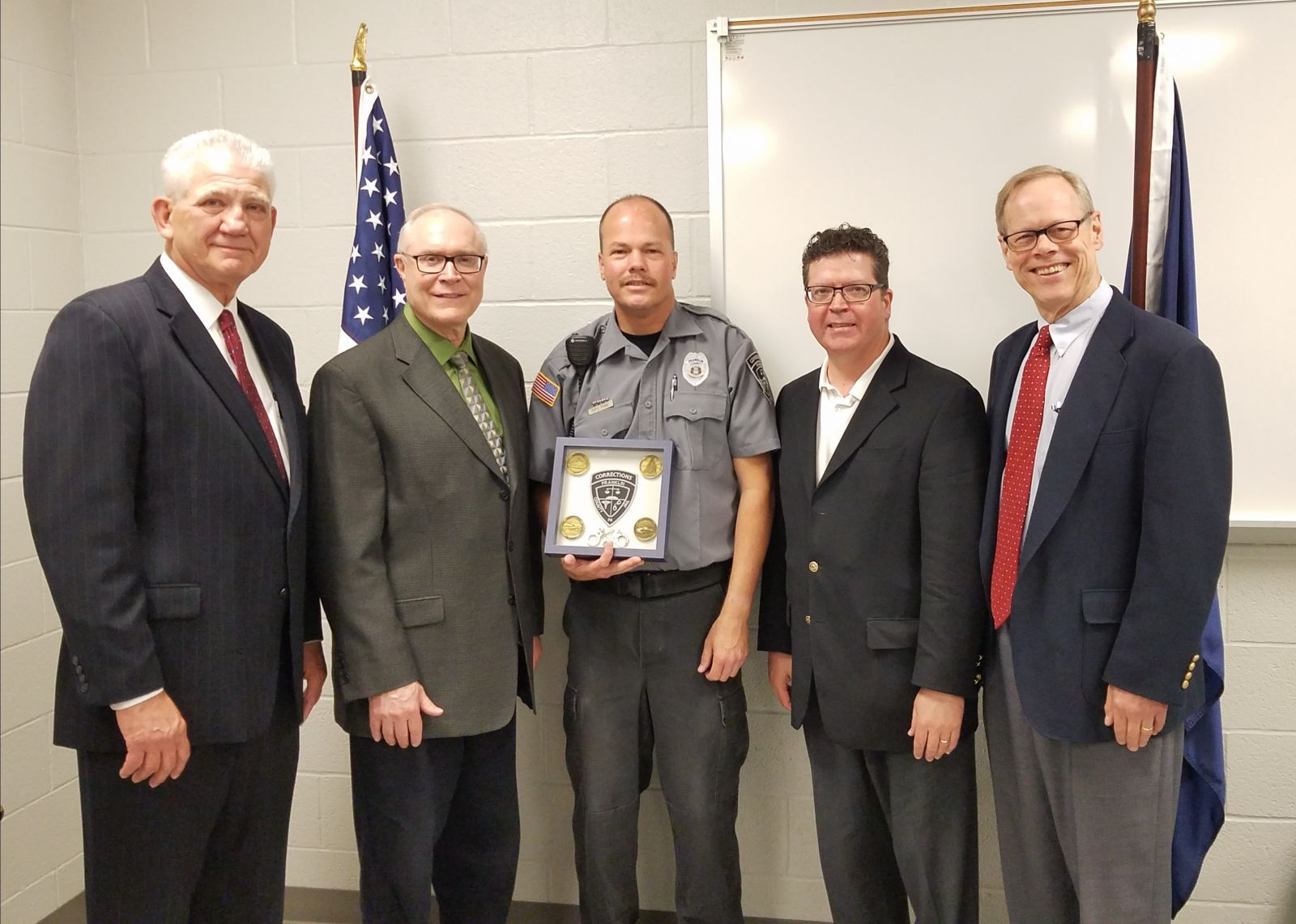 Pictured above, left to right: Former County Administrator John Hart, Commissioner Bob Thomas, Correctional Officer of the Year Robert Fink, Commissioner Chairman Dave Keller, Commissioner Bob Ziobrowski