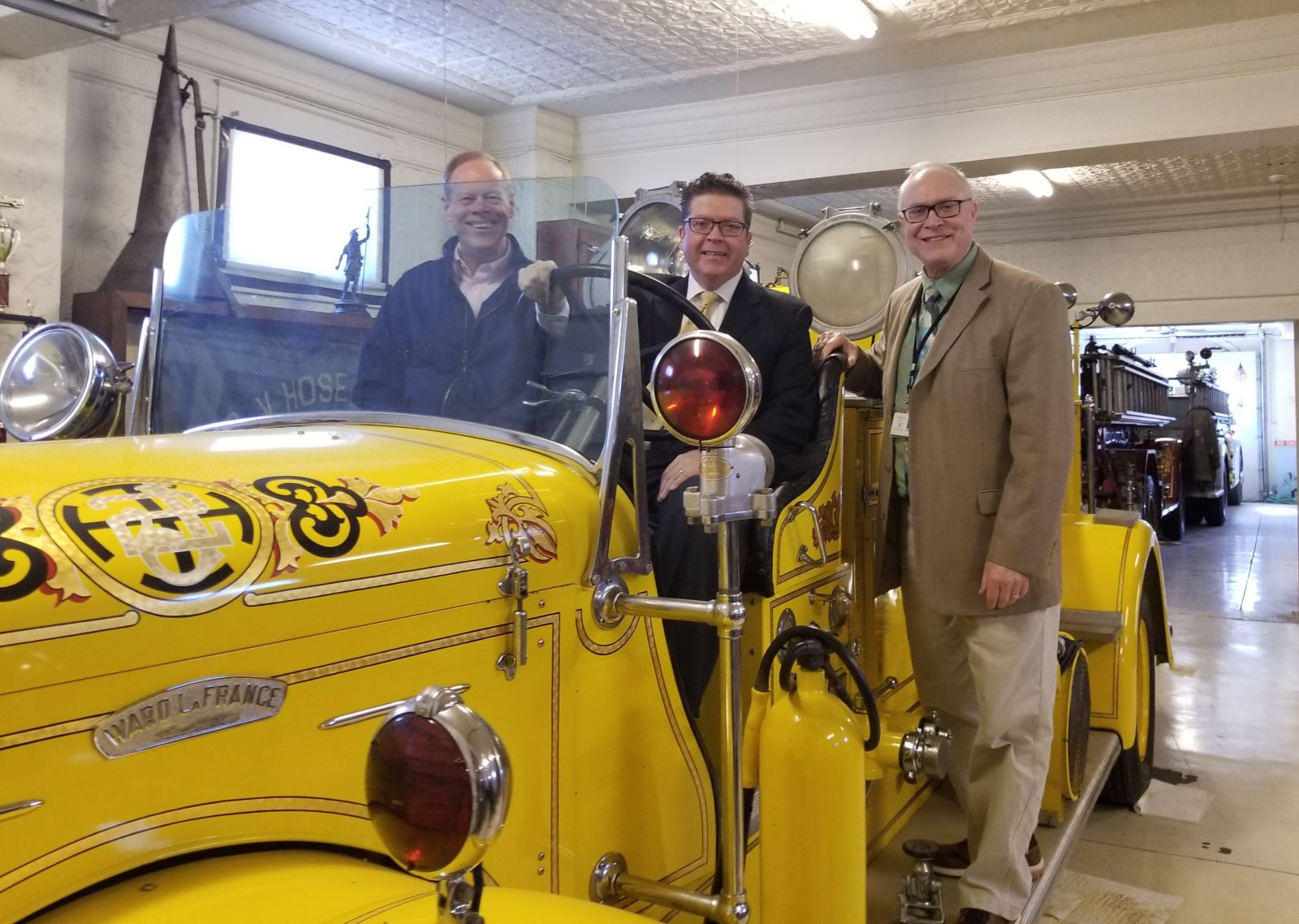 Commissioner Bob Ziobrowski, Commissioner Chairman Dave Keller, and Commissioner Bob Thomas in a fire truck at the Chambersburg Volunteer Fireman�s Museum.