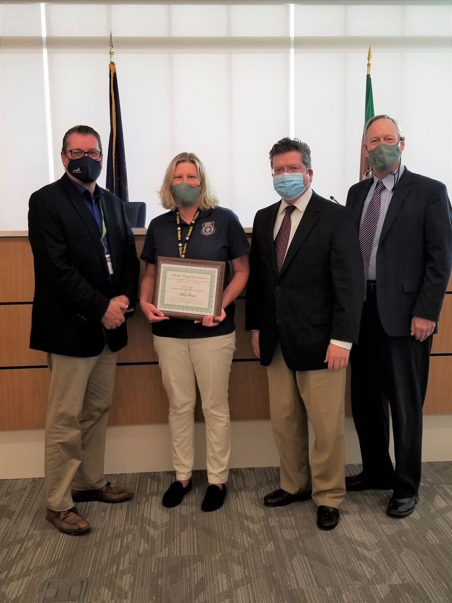 Commissioner John Flannery, Employee of the Month - Mary Seville, Chairman Commissioner Dave Keller, and Commissioner Bob Ziobrowski