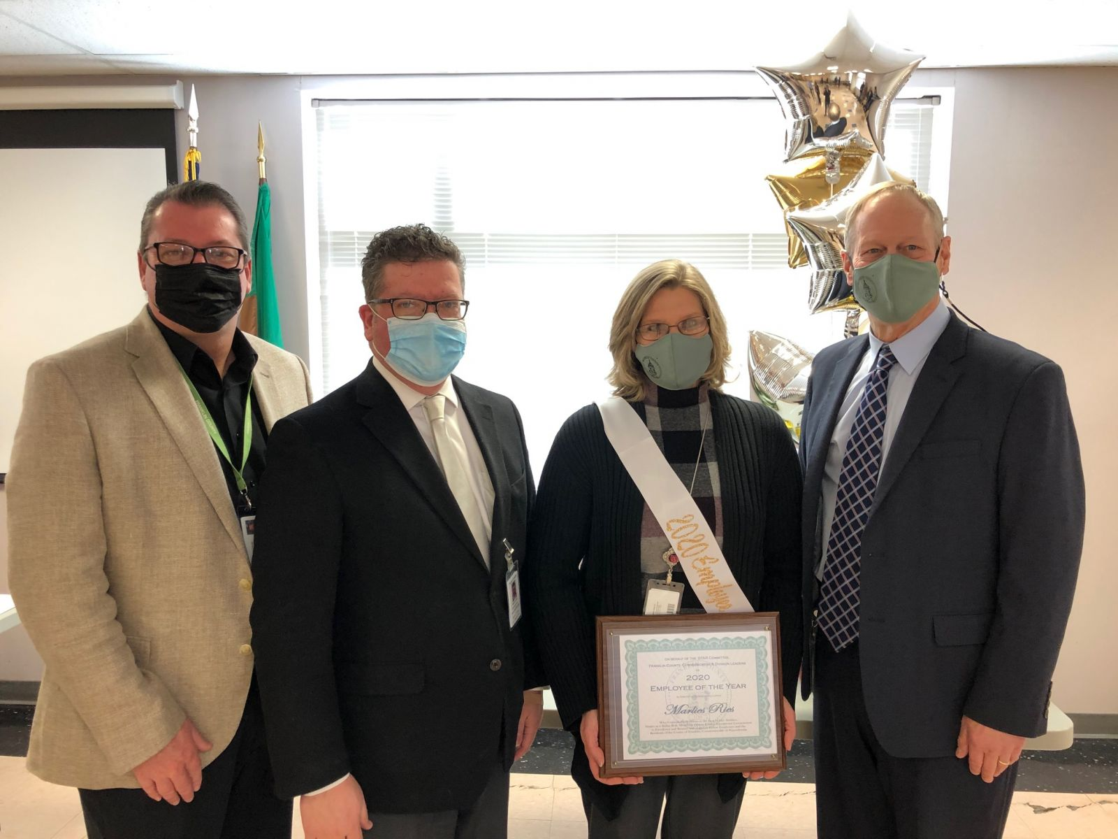 Pictured above (left to right): Commissioner John Flannery, Commissioner Chairman Dave Keller, 2020 Employee of the Year - AIS/Accounting Manager Marlies Ries, and Commissioner Bob Ziobrowski