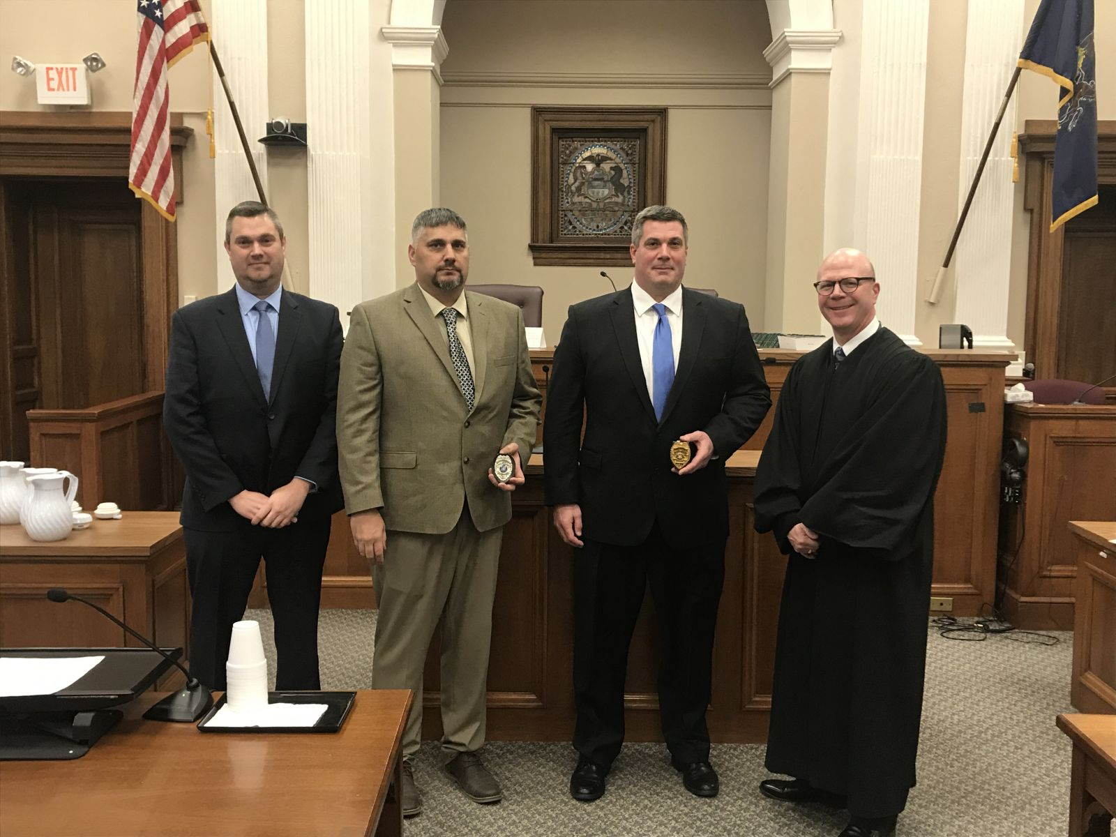 Pictured from left to right: Chief Douglas Wilburne, Officer William Rogers, Deputy Chief Geoffrey Willett, President Judge Shawn D. Meyers