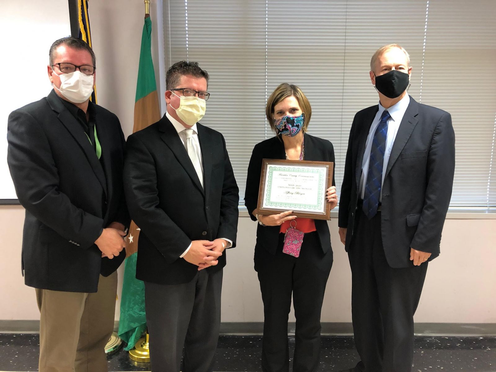 Pictured (left to right): Commissioner John Flannery, Commissioner Chairman Dave Keller, Human Services Director Tiffany Bloyer, and Commissioner Bob Ziobrowski