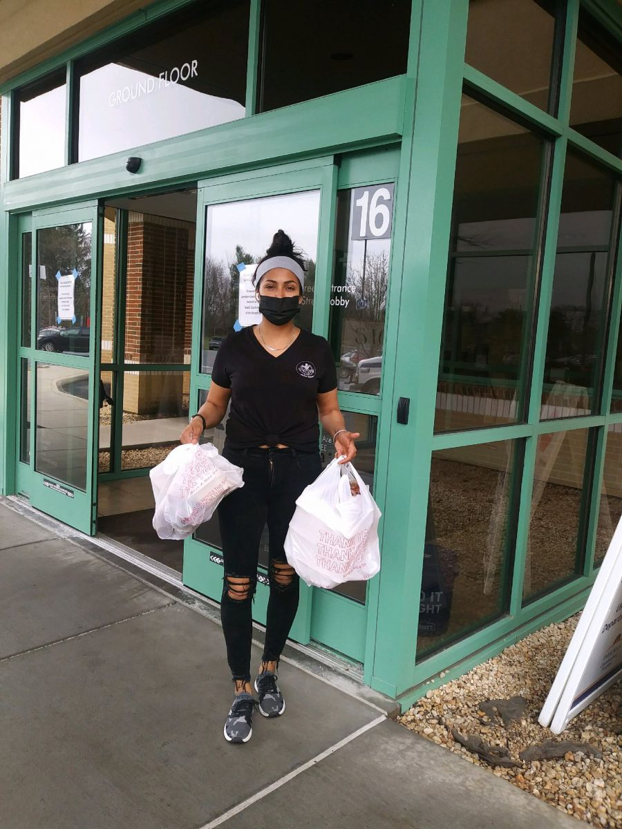 Above: Monica Mata of Veroni Cafe drops off meals donated by Franklin County employees to health care workers at Chambersburg Hospital.  Photo by: Sharon Berbert
