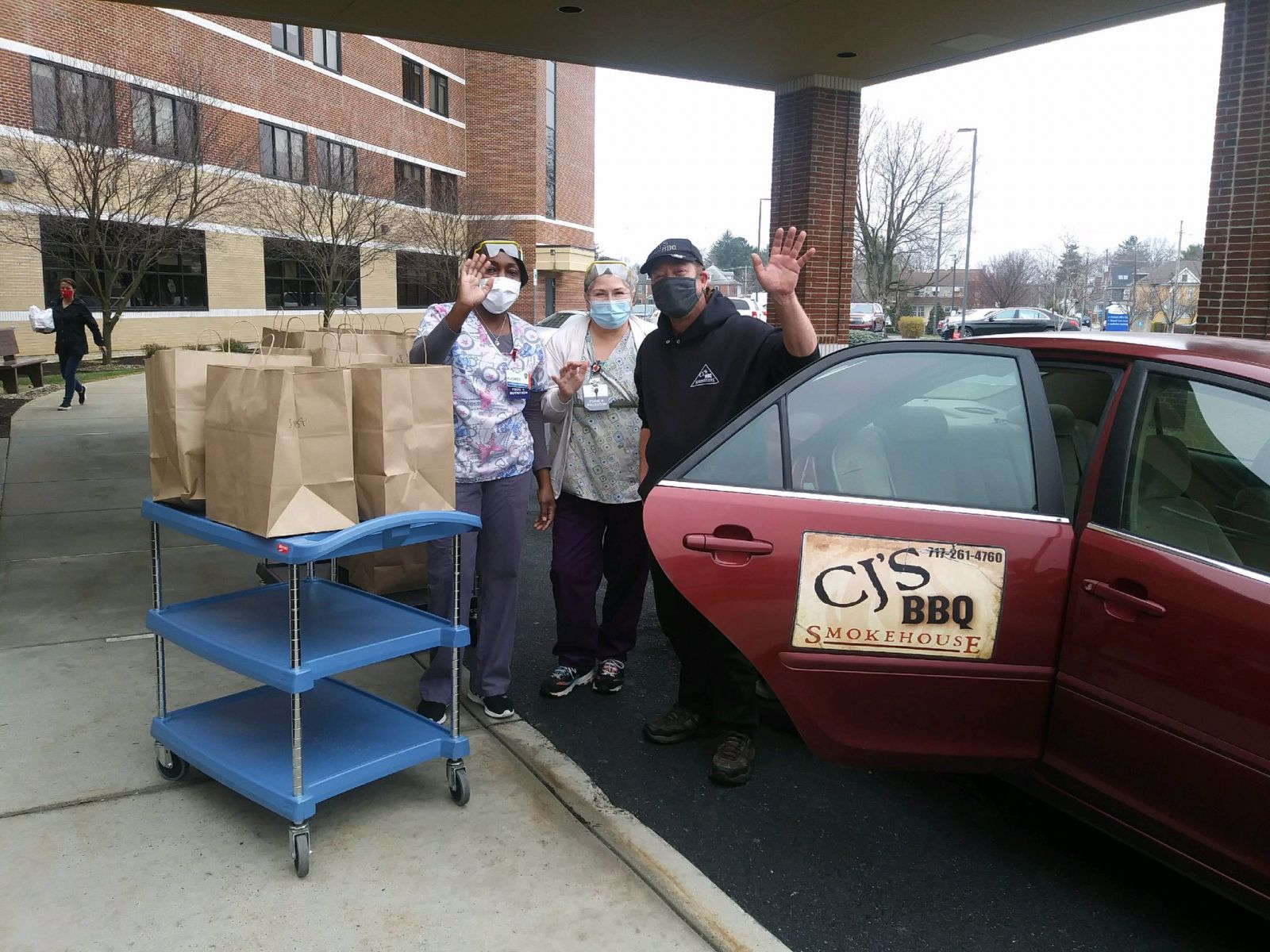 Jim Frey from CJ's BBQ Smokehouse drops off meals donated by Franklin County employees to health care workers at Chambersburg Hospital.  Photo by: Sharon Berbert