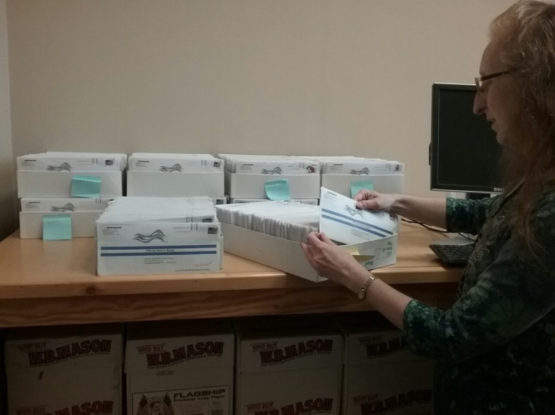 Photo: Voter Registration Chief Registrar Jennie Aines processing returned Absentee and Mail-in ballots.