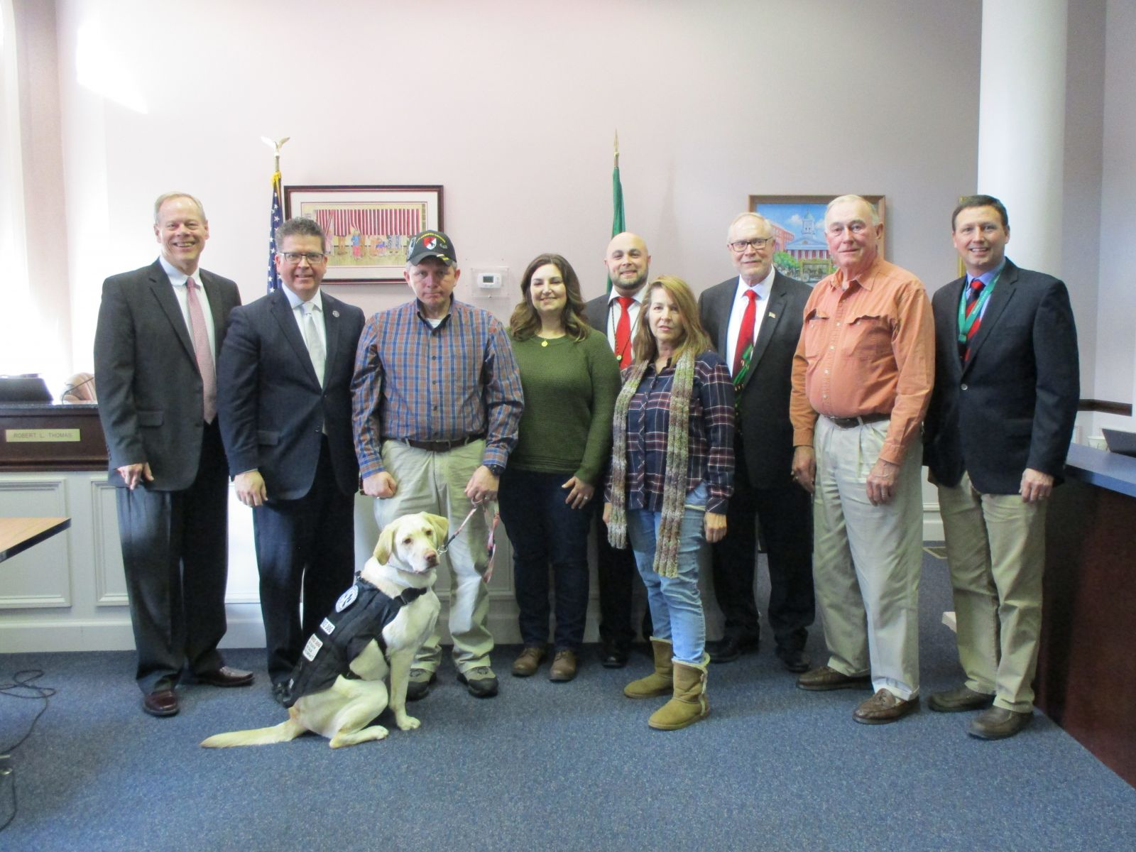 Picture (from left to right): Commissioner Robert G. Ziobrowski, Chairman David S.  Keller, Veteran Johnny Gouge and his wife Jessica with Skylar, Veteran Affairs Director Justin Slep, Trainer Helen Carlson, Foster Parent Tom Kennedy, and Community Outreach and Events Coordinator John McPaul.