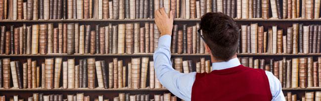 Man picking book